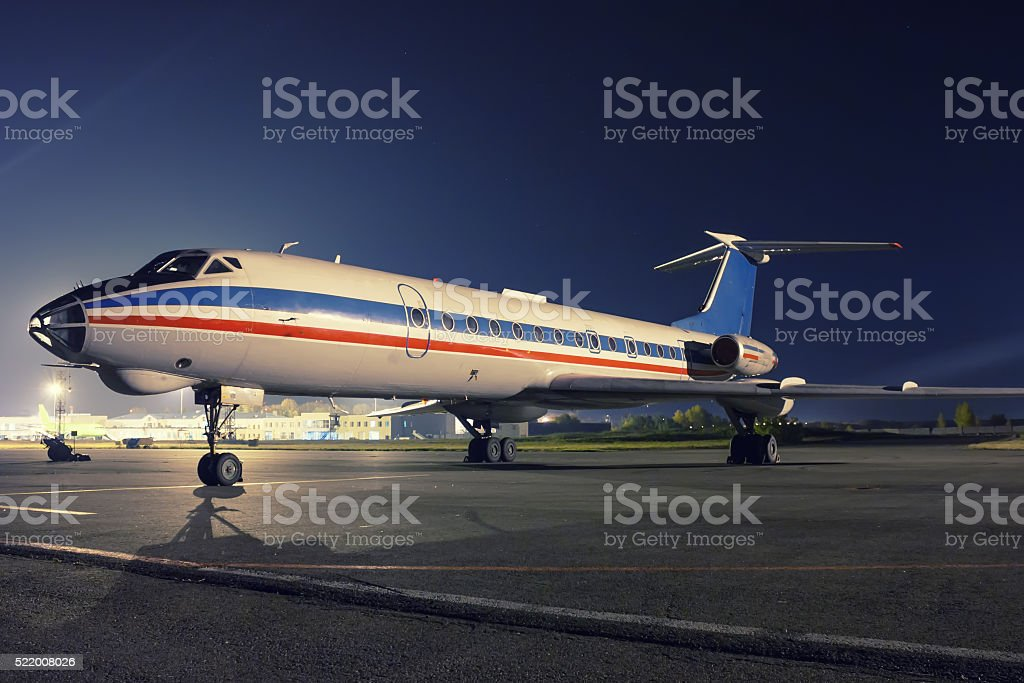 Sleeping airplane in the night apron royalty-free stock photo