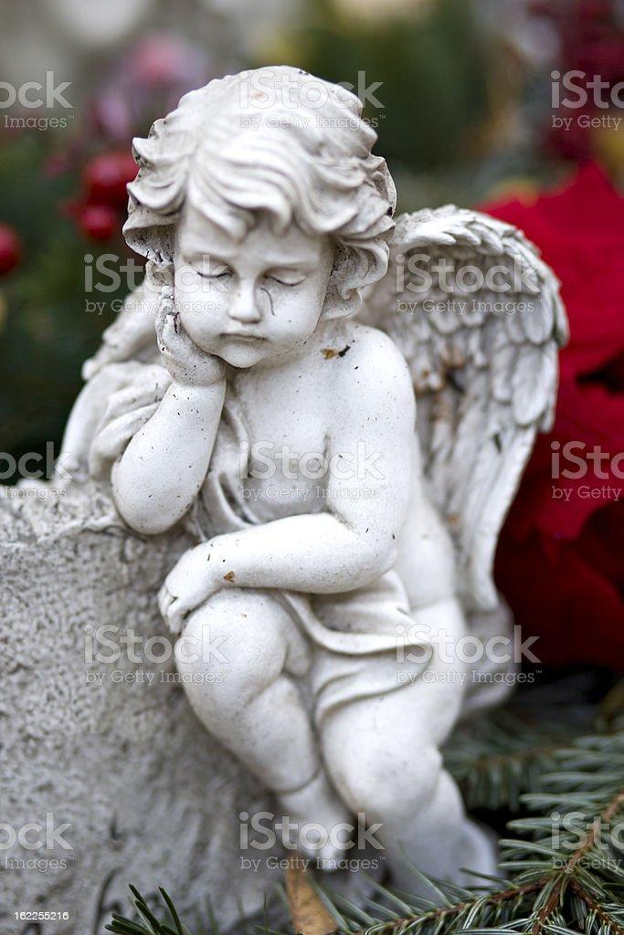 Sleeping angel on a grave stock photo