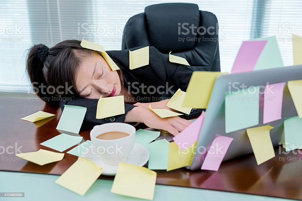 sleeping at laptop stock photo