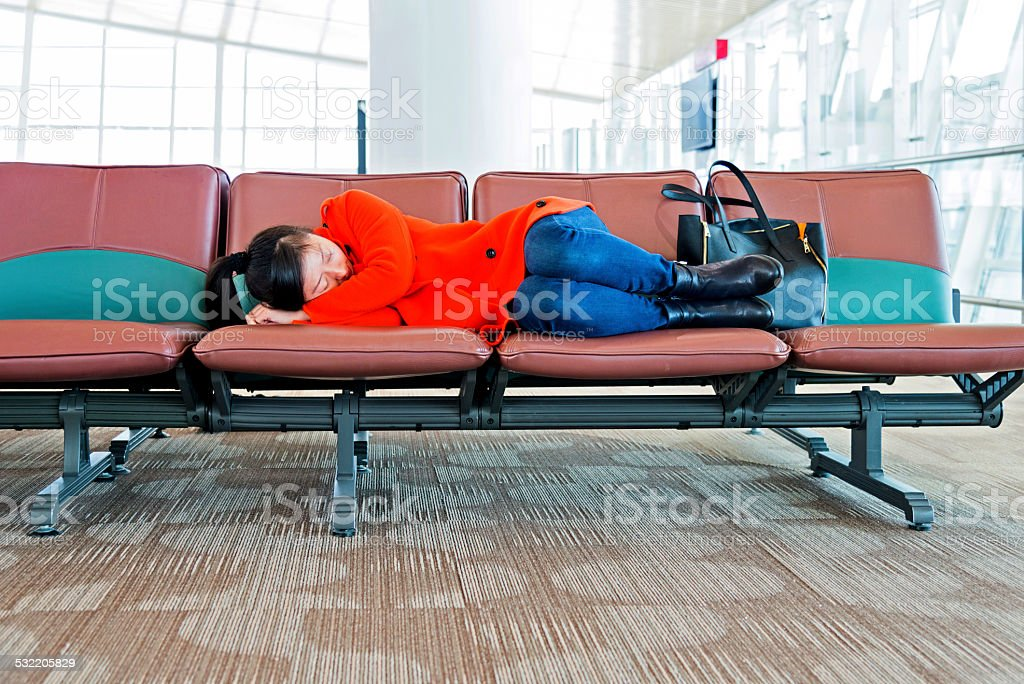 Sleeping at the airport stock photo