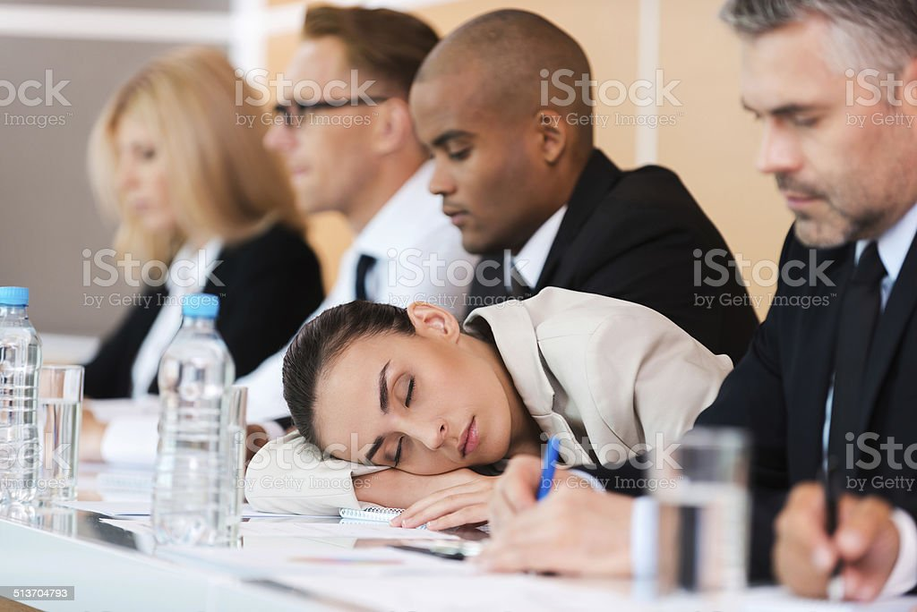 Sleeping at the conference. stock photo
