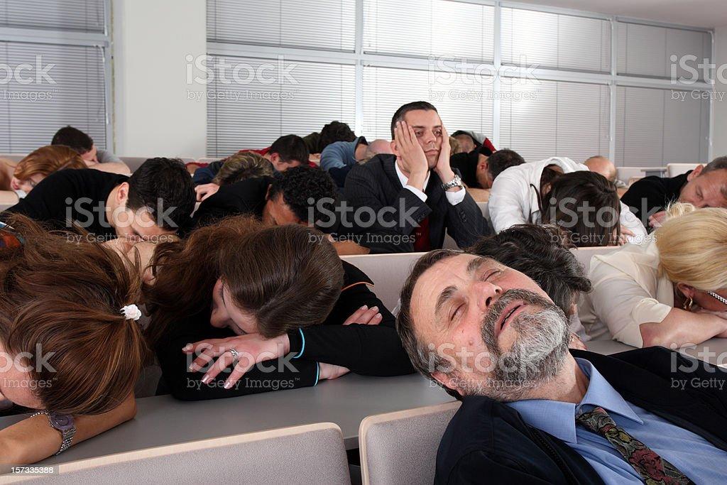 Sleeping audience at a boring business seminar stock photo