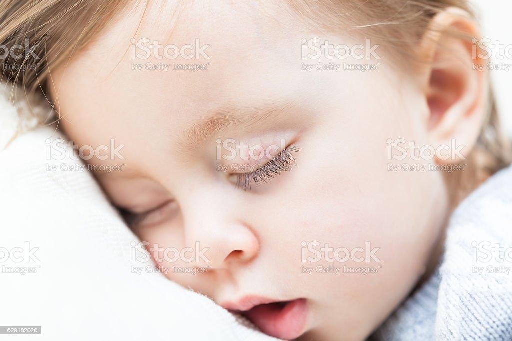 Sleeping baby face stock photo