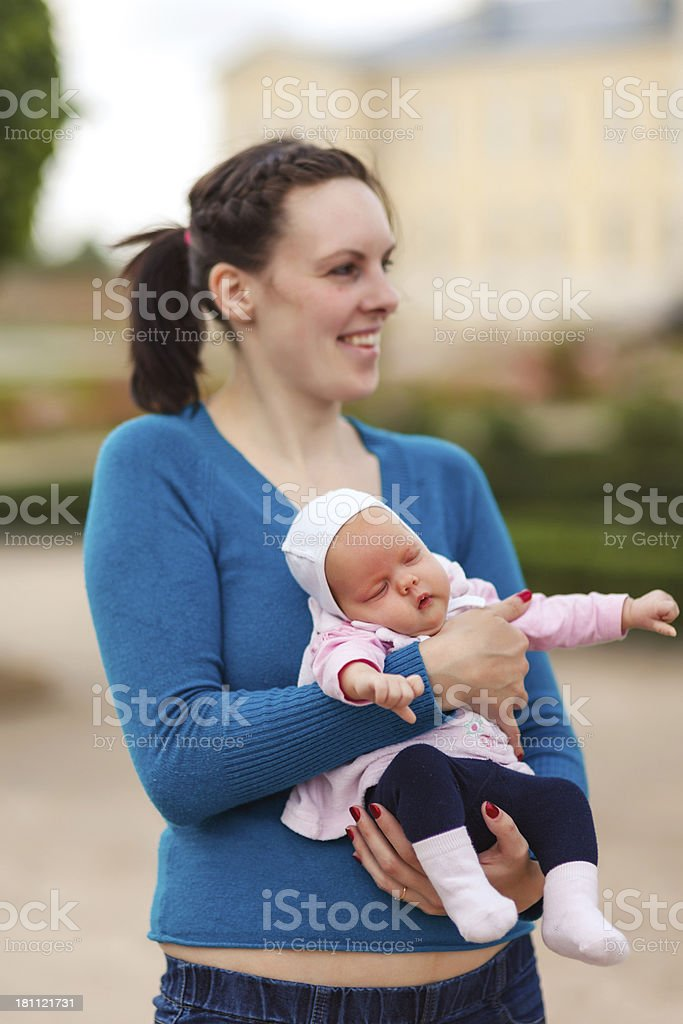 Sleeping Baby girl in mother's hands royalty-free stock photo
