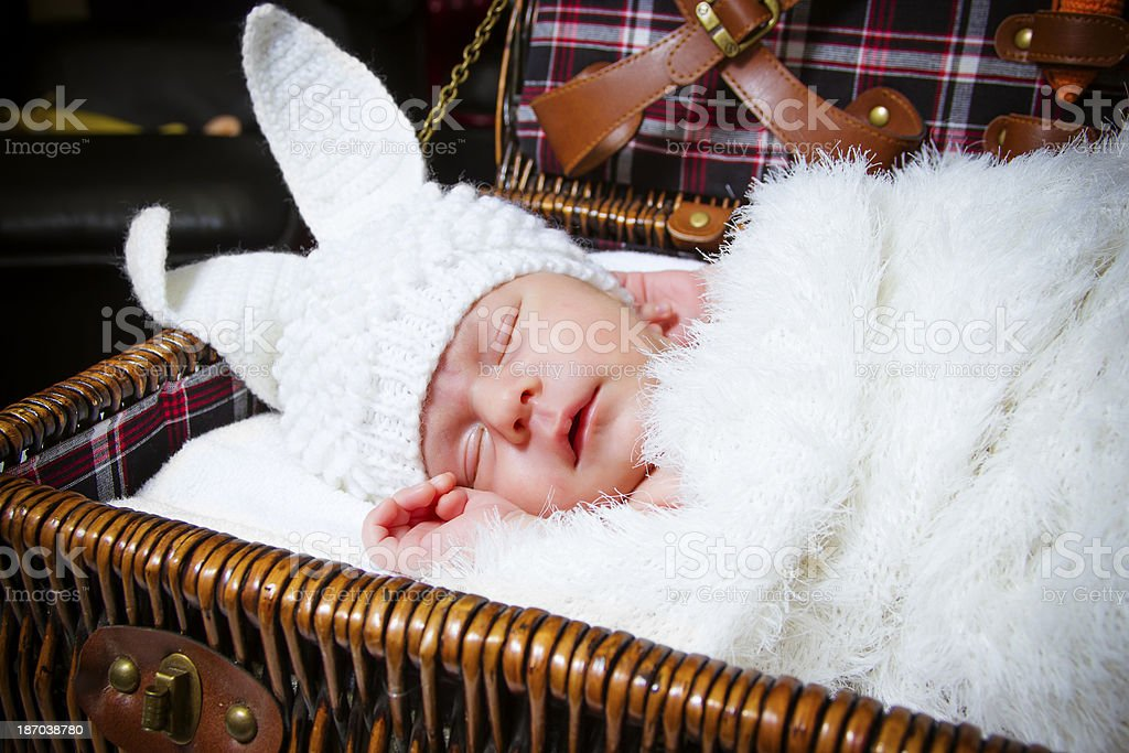 sleeping baby in a suit of rabbit royalty-free stock photo