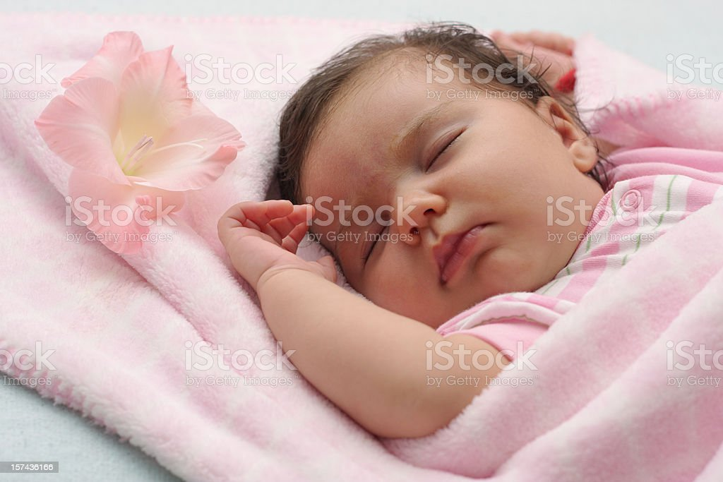 Sleeping baby with flower royalty-free stock photo