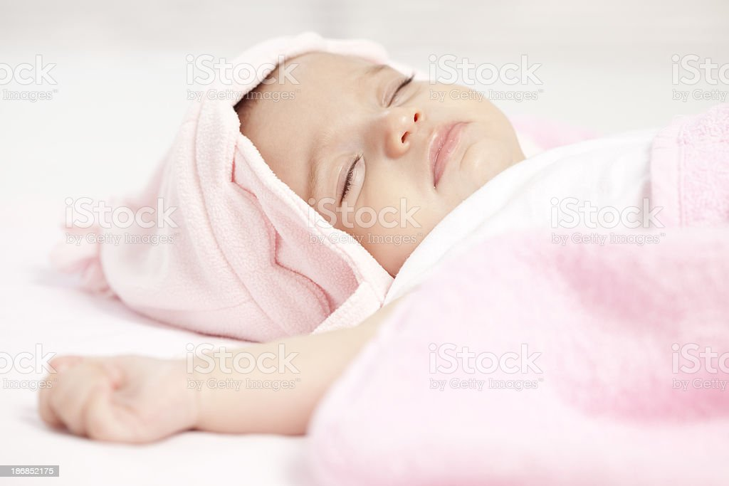 Sleeping baby with pink hat. royalty-free stock photo