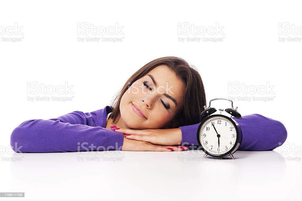Sleeping beautiful woman with alarm clock royalty-free stock photo