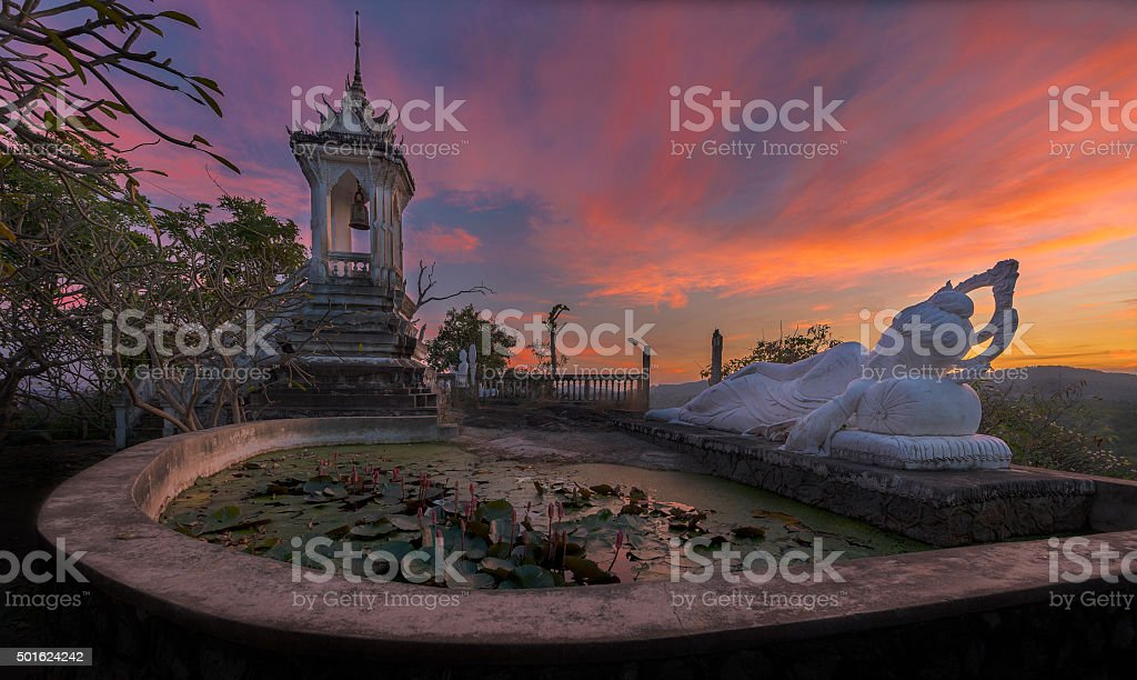 Sleeping Buddha and belfry on sunset at Hua-Hin,Thailand stock photo