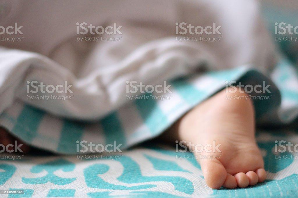Sleeping child cute  foot stock photo