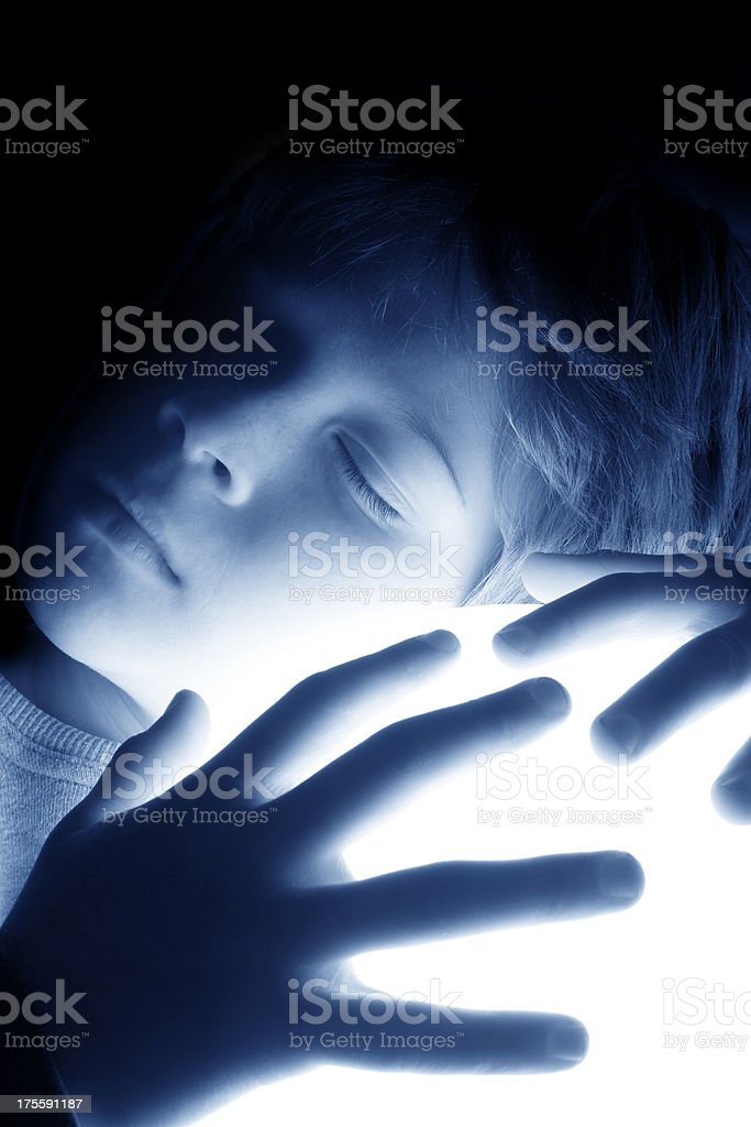 Sleeping child holding a ball of light stock photo
