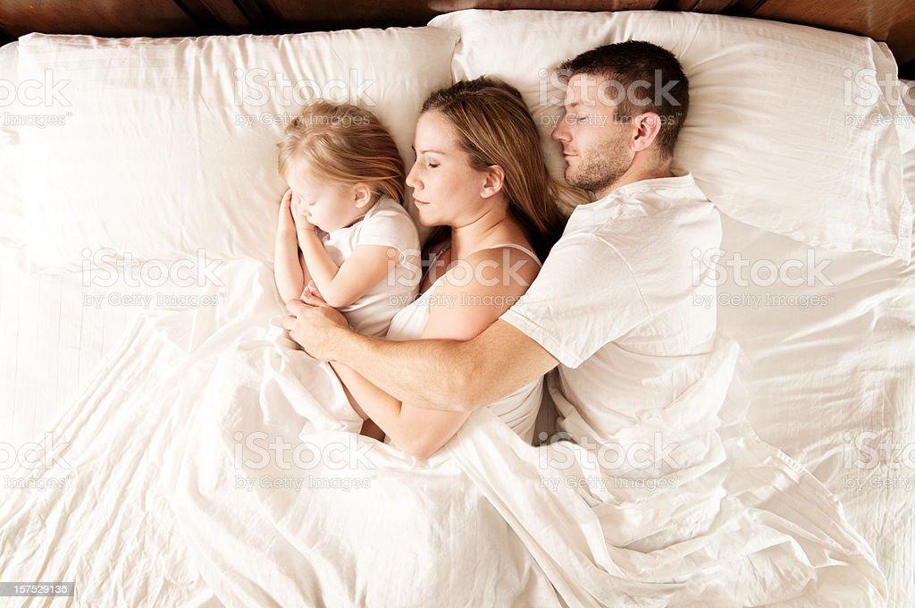 Sleeping Family stock photo