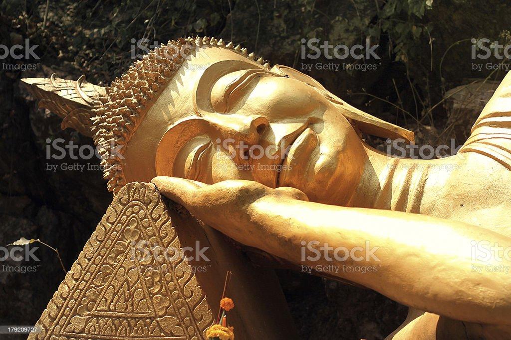 sleeping golden Buddha in Luang Prabang stock photo