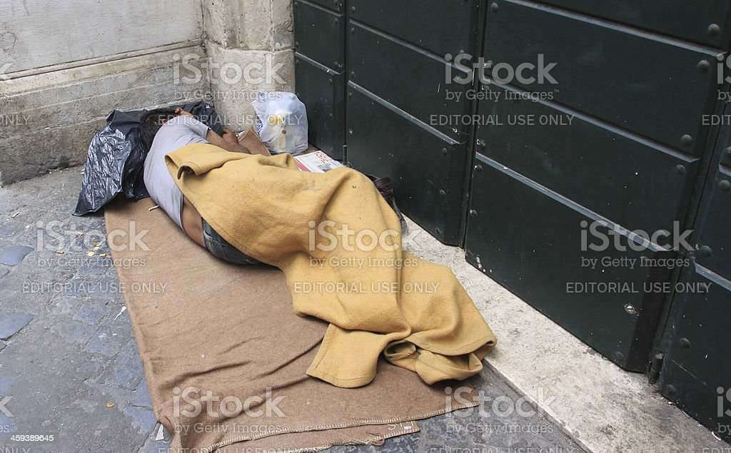 Sleeping homeless stock photo