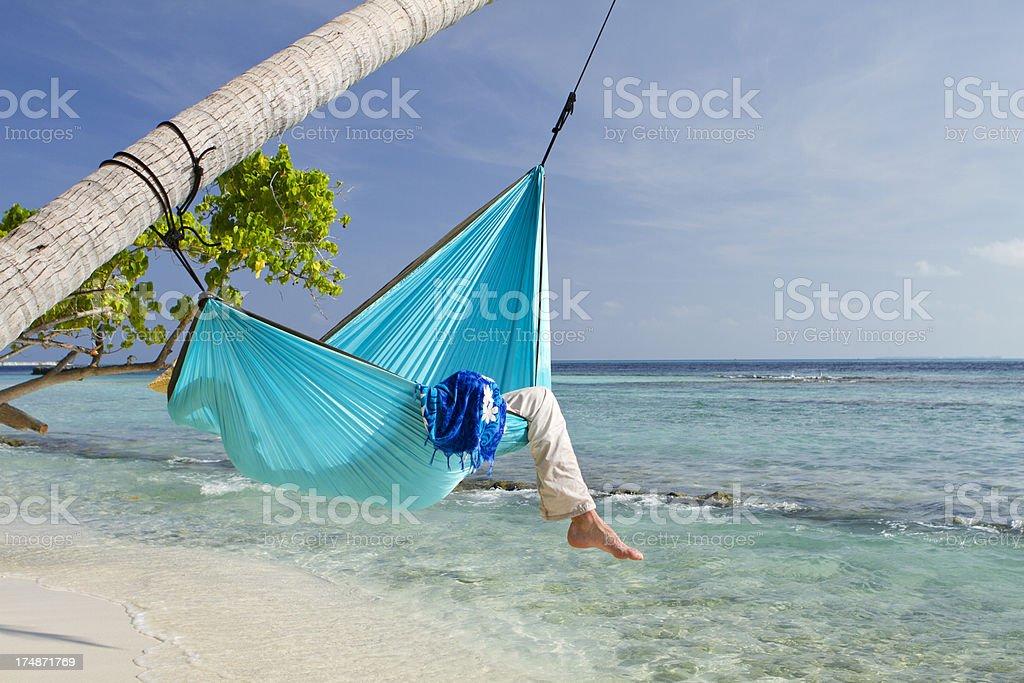 Sleeping in a hammock near the sea royalty-free stock photo
