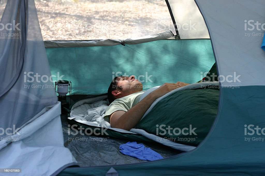Sleeping in a tent royalty-free stock photo