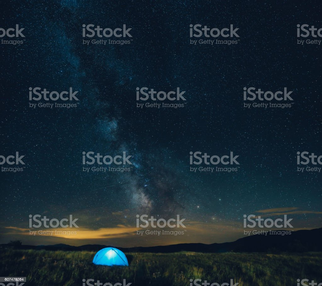 Sleeping in a tent under the starry sky stock photo