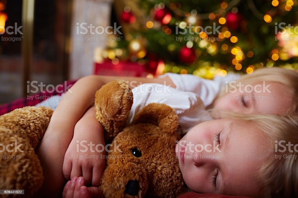 sleeping in Christmas Eve near New Year tree stock photo
