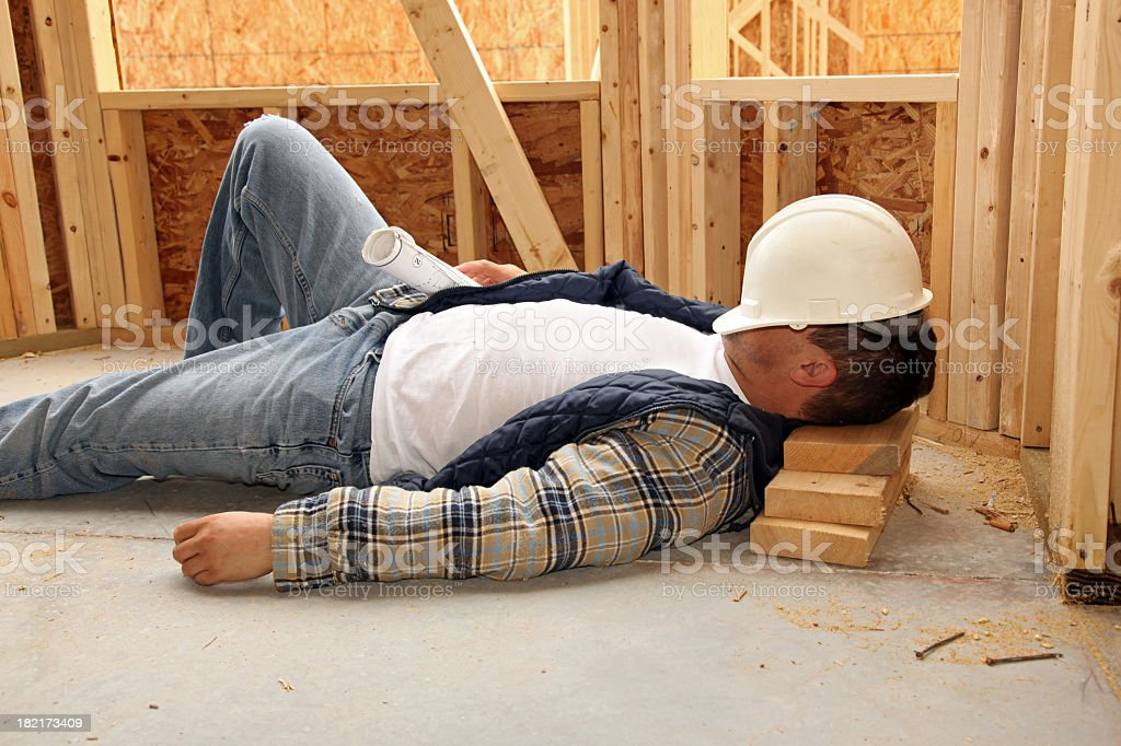 Sleeping man in construction site stock photo