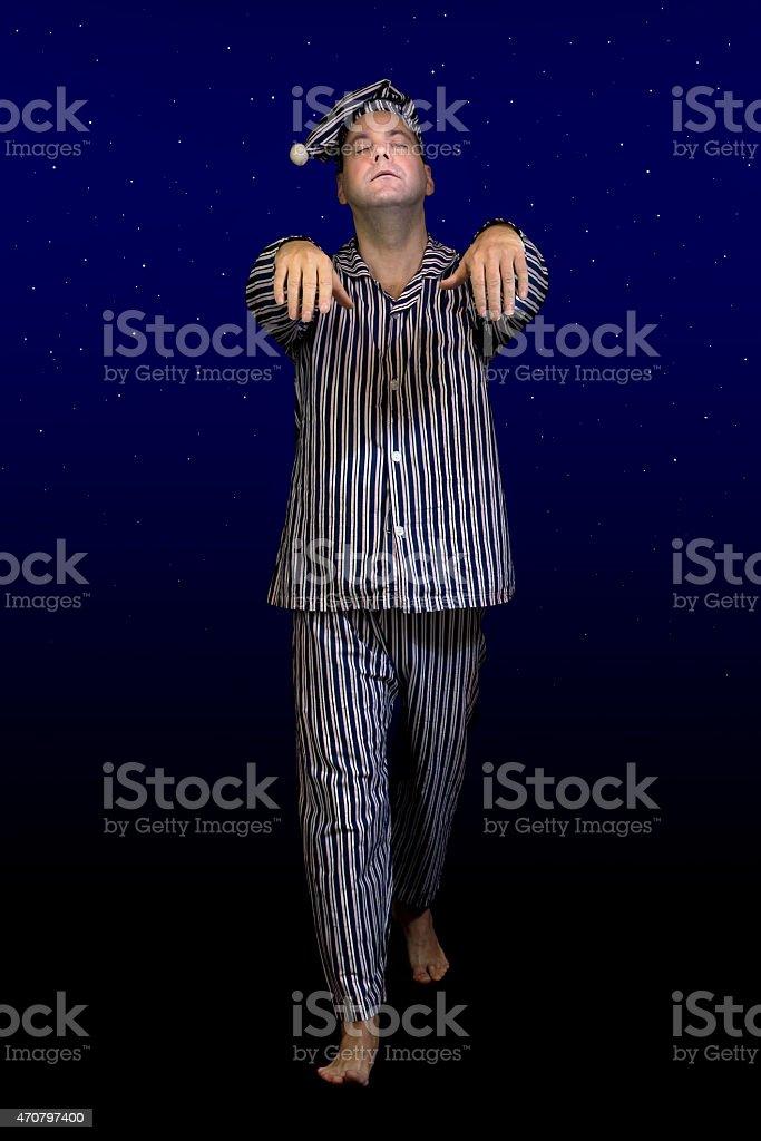 sleeping man walks in pajamas stock photo