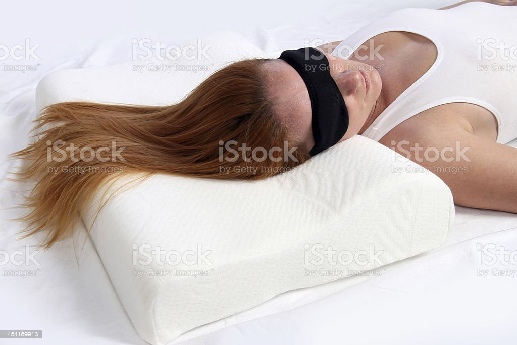sleeping mask and orthopedic pillow stock photo