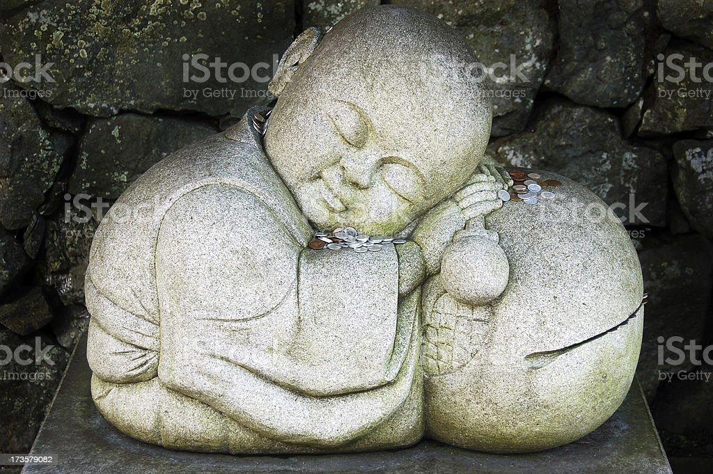 Sleeping Money Buddha stock photo