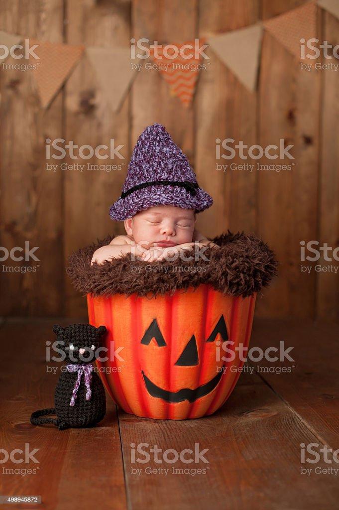 Sleeping Newborn Baby Girl Wearing a Witch Costume stock photo