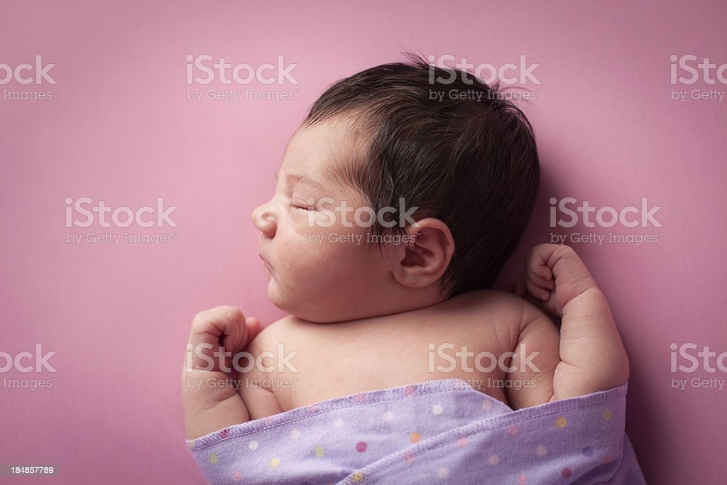Sleeping Newborn Baby Girl Wrapped in Polka Dot Blanket royalty-free stock photo