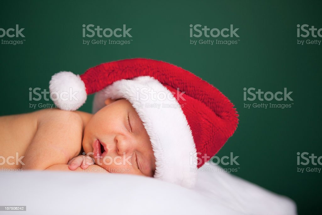 Sleeping Newborn Baby Wearing Santa Hat for Christmas royalty-free stock photo