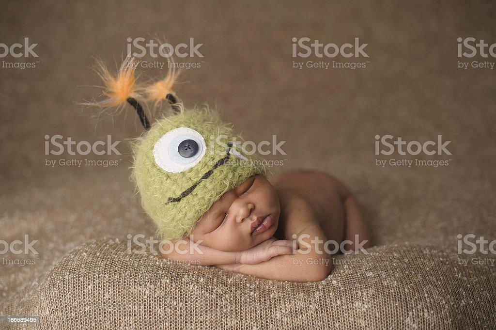 Sleeping Newborn Boy in Monster Hat stock photo