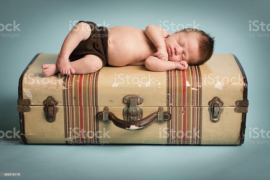 Sleeping Newborn Lying on Striped, Vintage Suitcase royalty-free stock photo