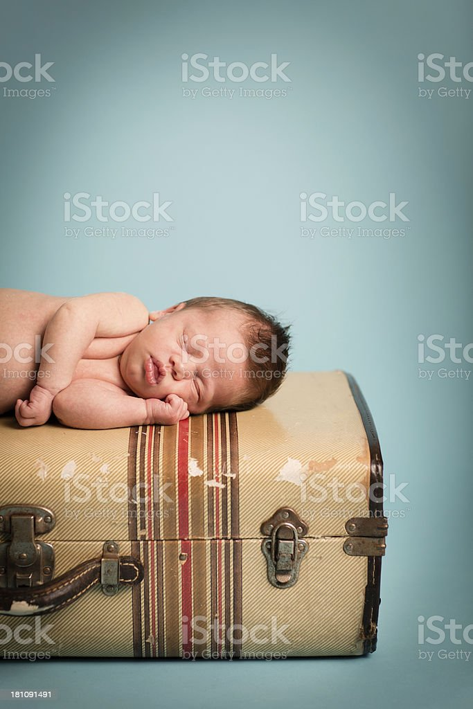 Sleeping Newborn Lying on Striped, Vintage Suitcase, With Copy Space royalty-free stock photo