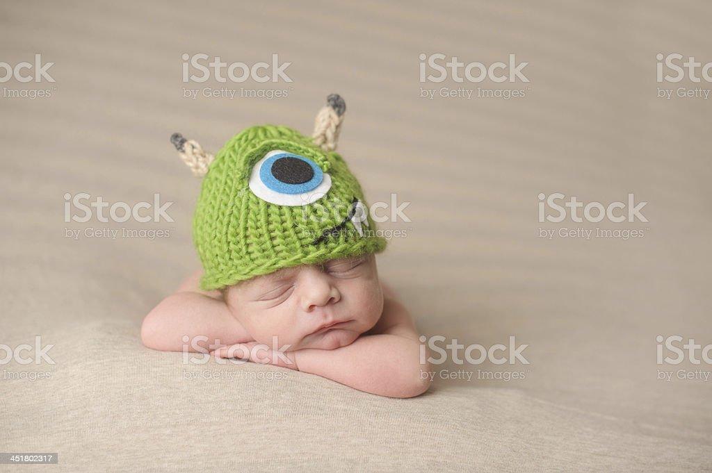 Sleeping Newborn Wearing hat. stock photo