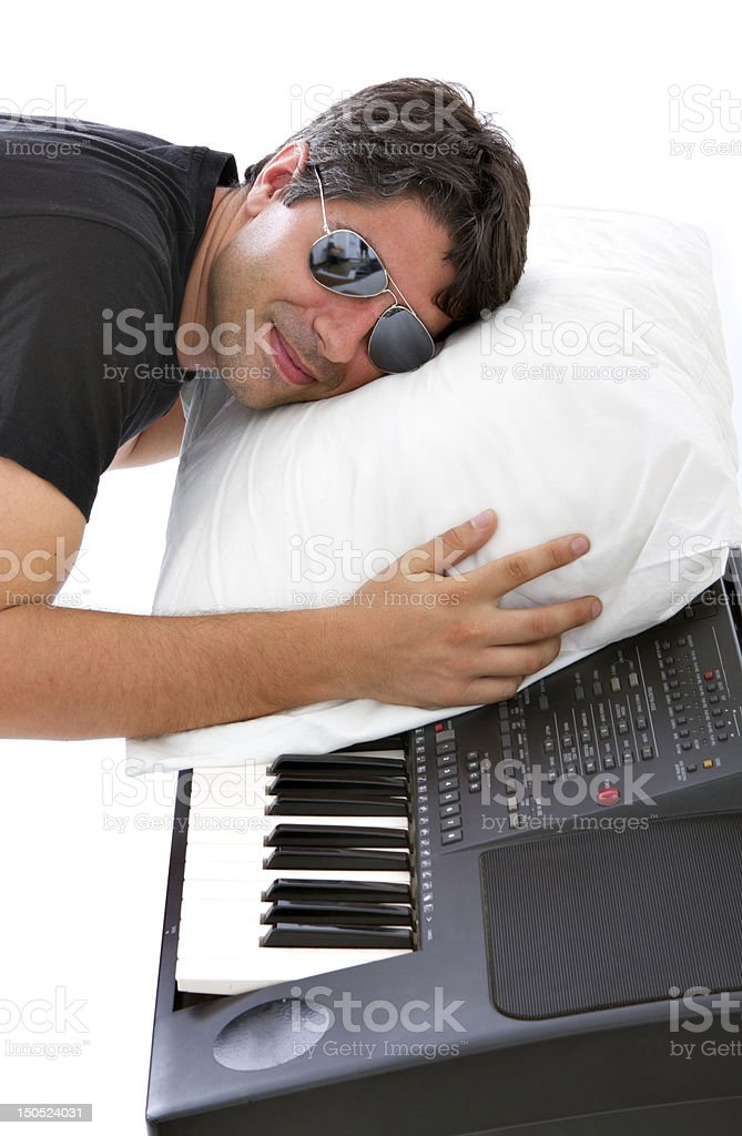 sleeping on a piano lullaby stock photo