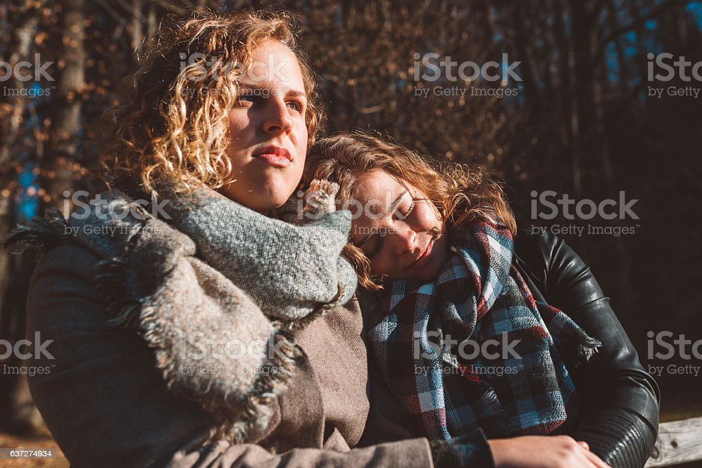 Sleeping on a shoulder stock photo