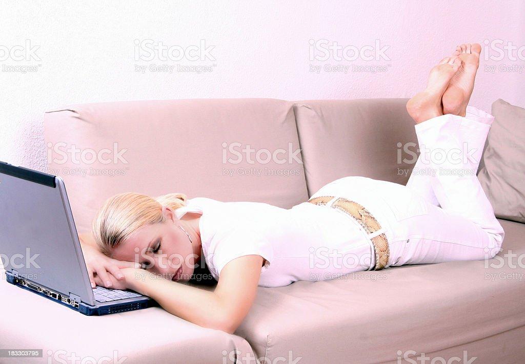 Sleeping on notebook stock photo
