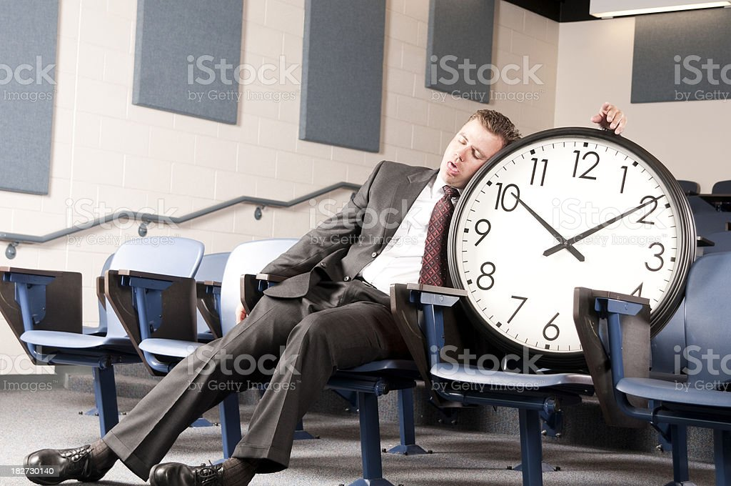 Sleeping on the clock stock photo