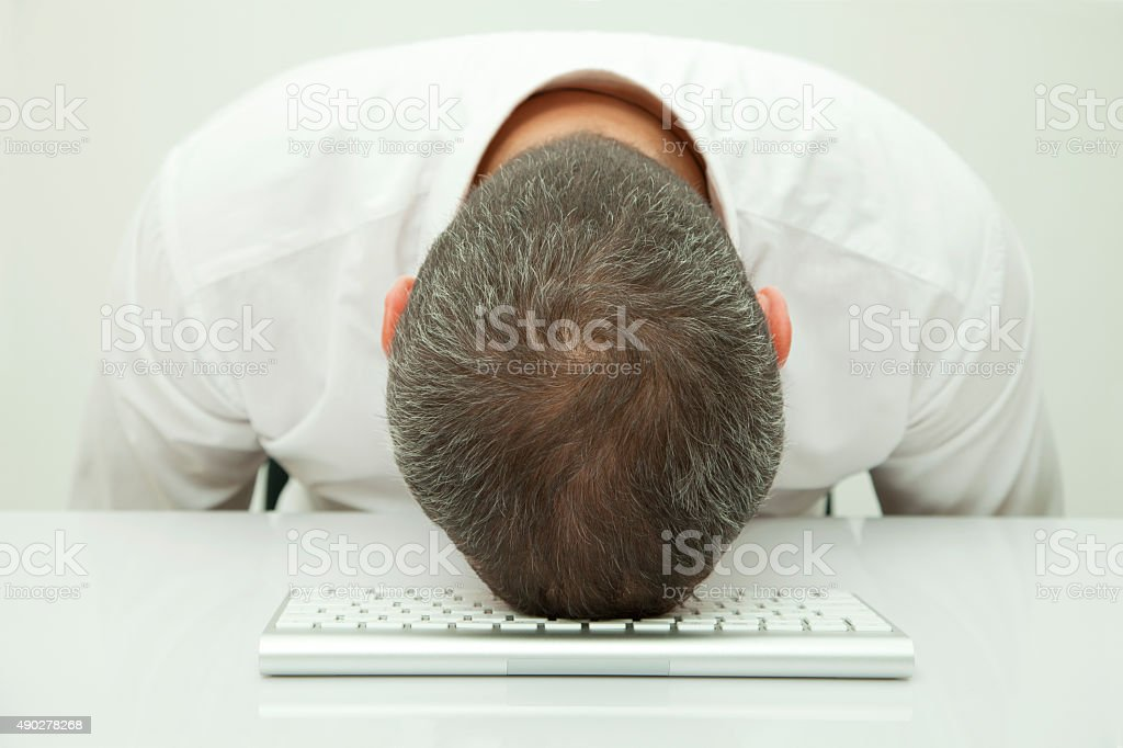 sleeping on the desk stock photo