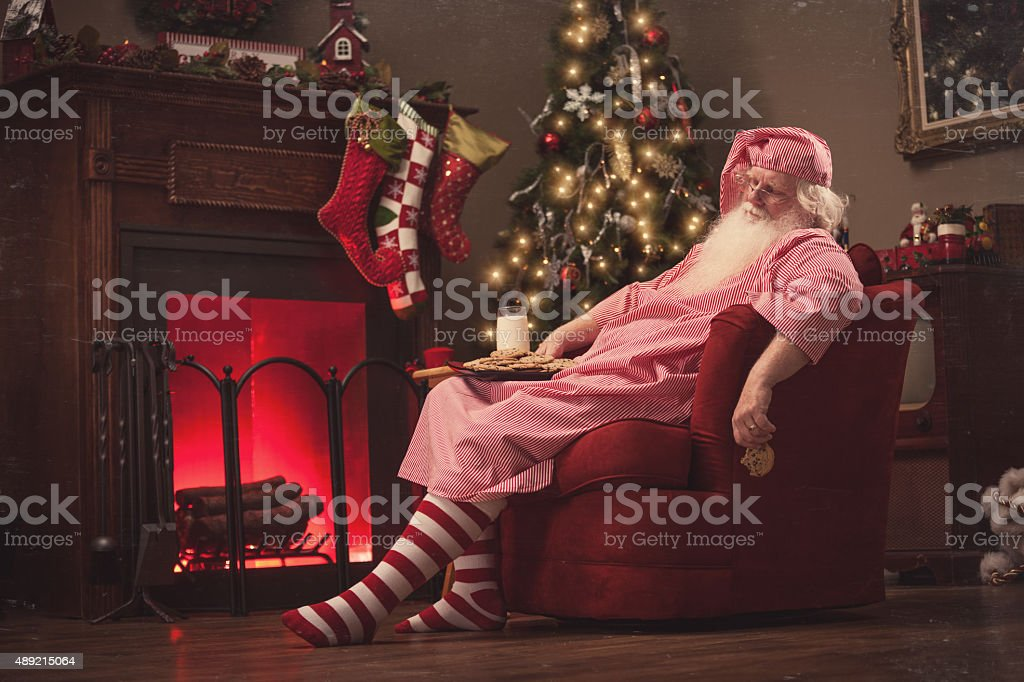 Sleeping Santa in Sofa Chair with Milk and Cookies-Vintage stock photo