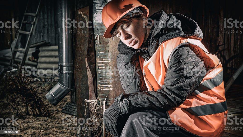 Sleeping sitting worker stock photo