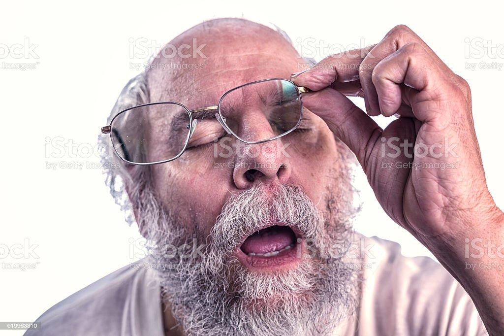 Sleeping Snoring Hangover Senior Adult Man Struggling With Eyeglasses stock photo