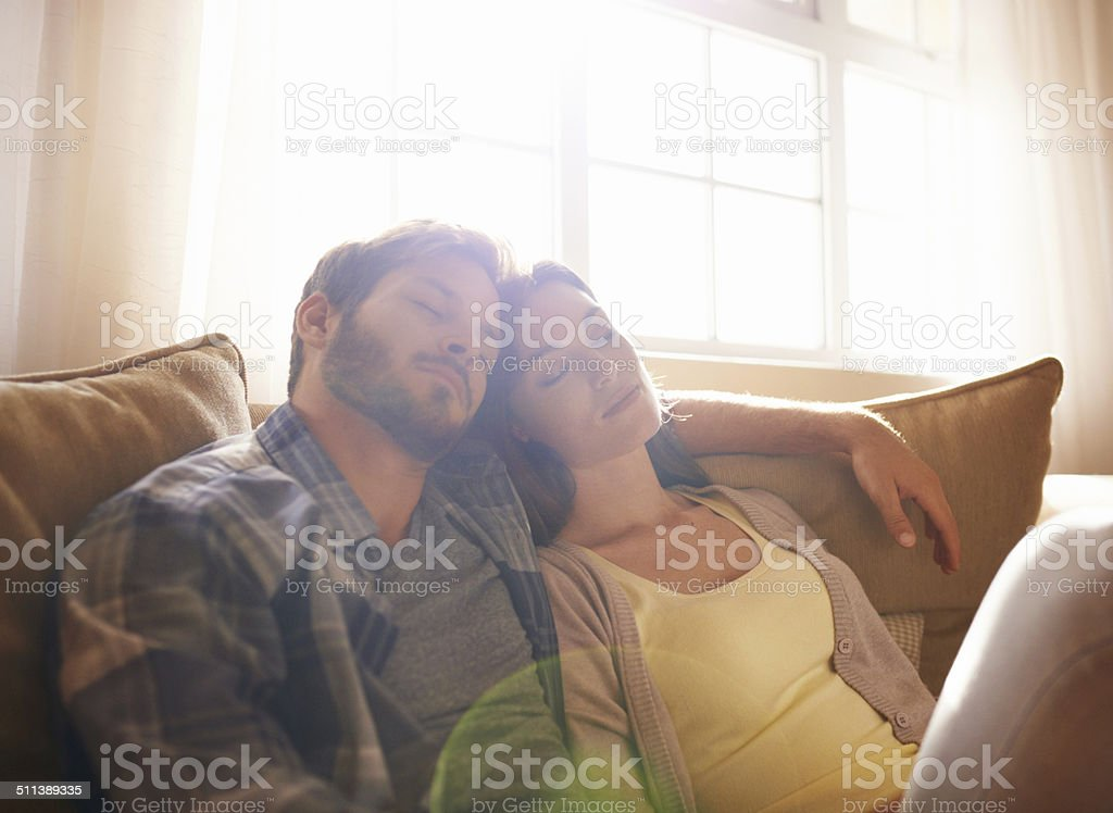 Sleeping soundly on the sofa stock photo