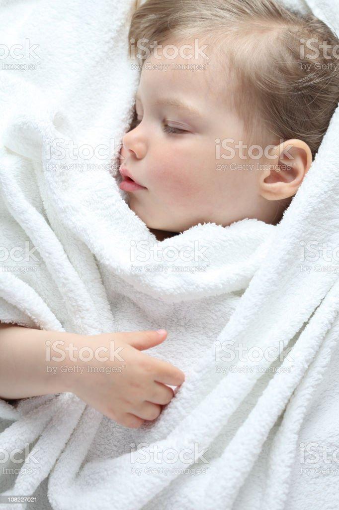 Sleeping Toddler Wrapped in White Blanket royalty-free stock photo