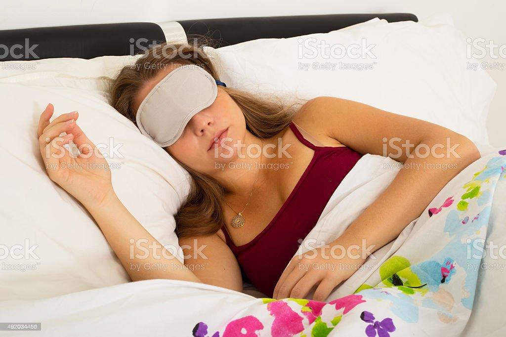 sleeping with eye mask royalty-free stock photo