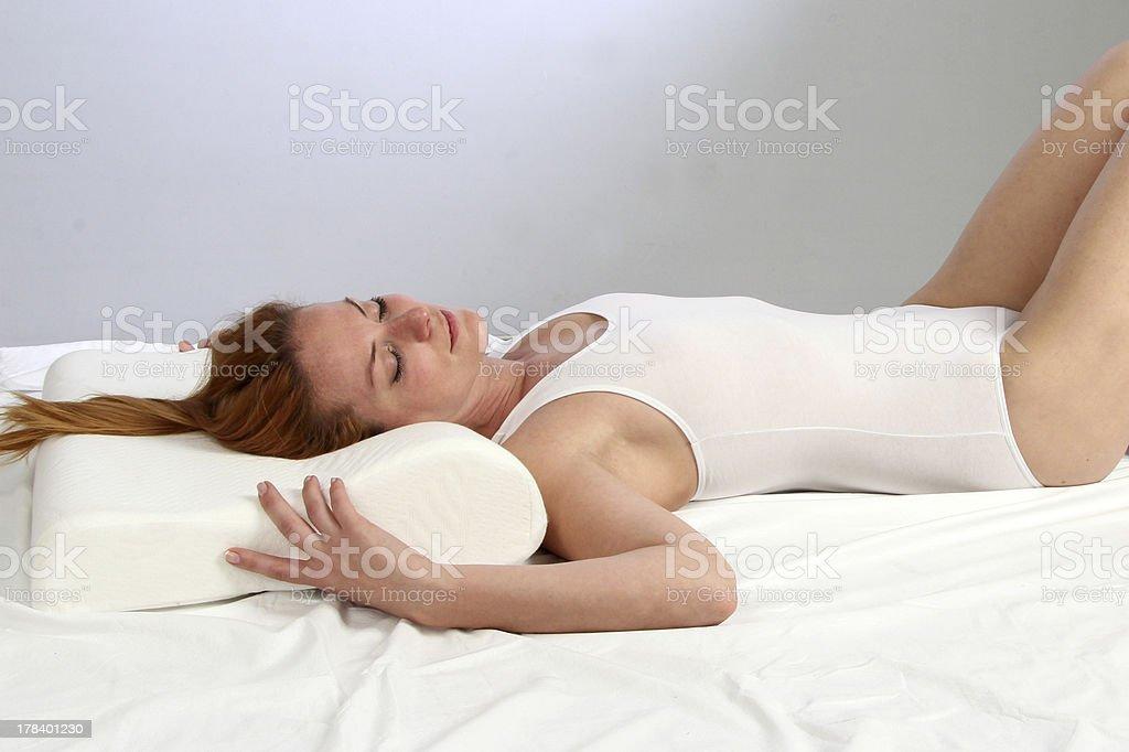 sleeping with orthopedic pillow stock photo