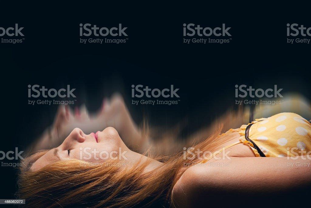 Sleeping Woman Having a Nightmare stock photo