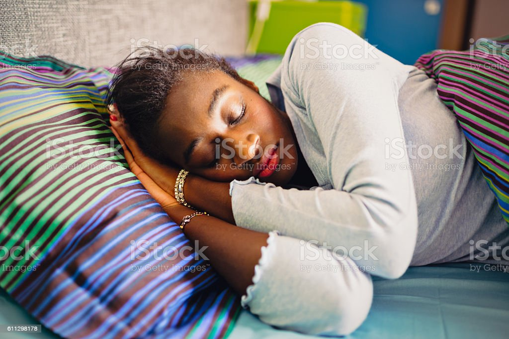 Sleeping young African woman stock photo
