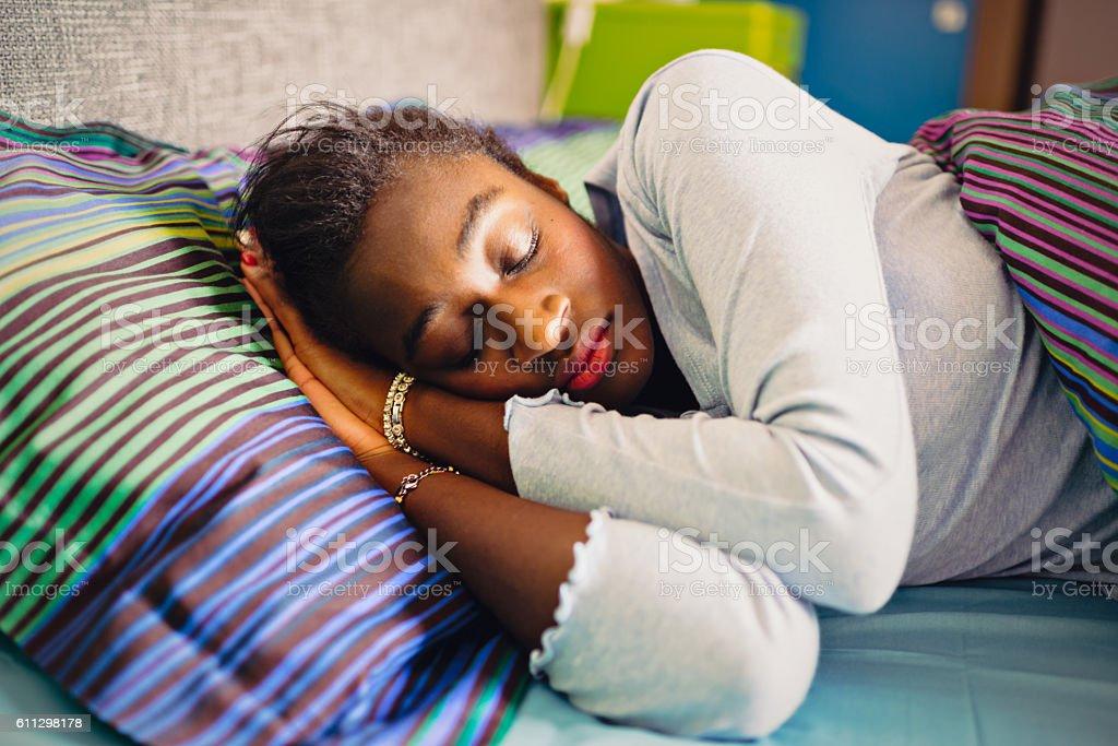Sleeping young African woman stock photo
