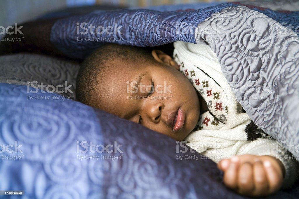 Sleeping young boy stock photo