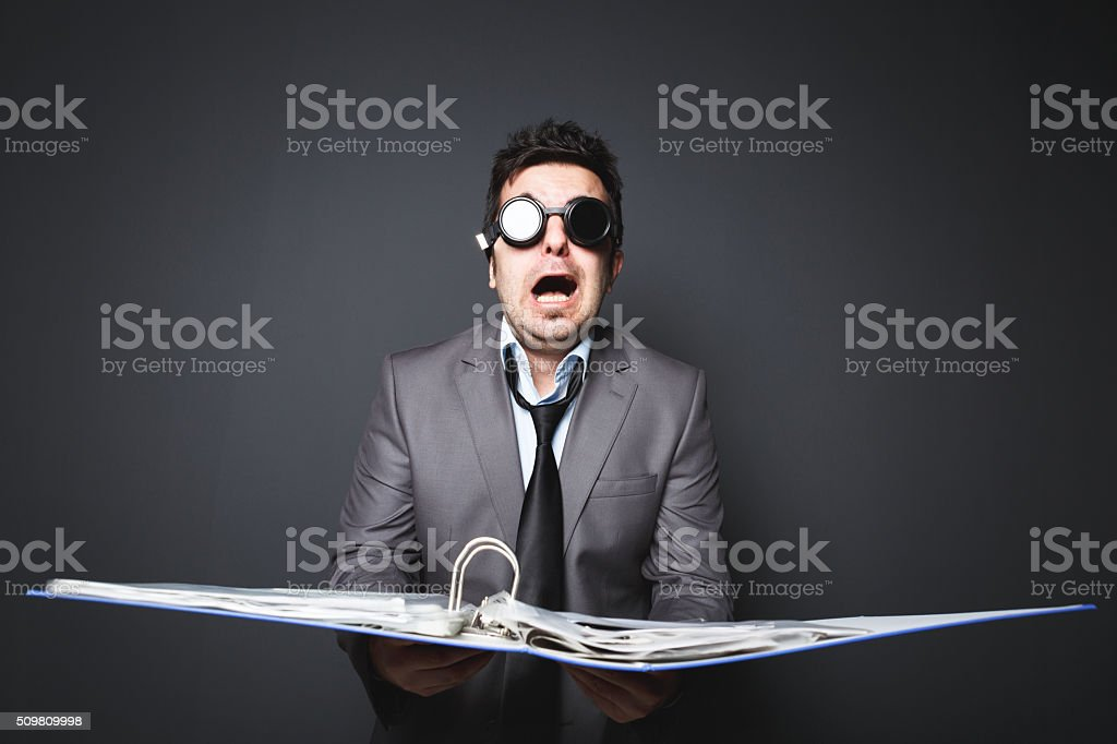 Sleepless businessman a lot of work holding document stock photo